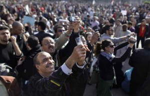 Cellphones and Egyptian demonstrators celebrating